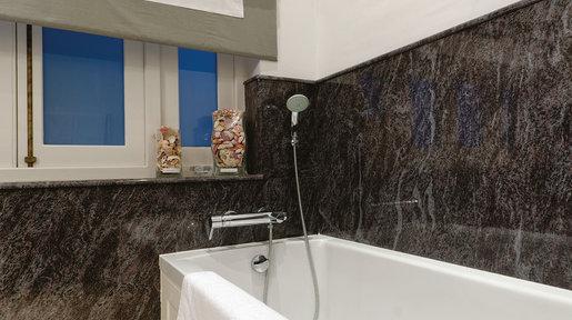 Dark grey marble. Grey and white Roman blind by Biggie Best. © Alan Carville