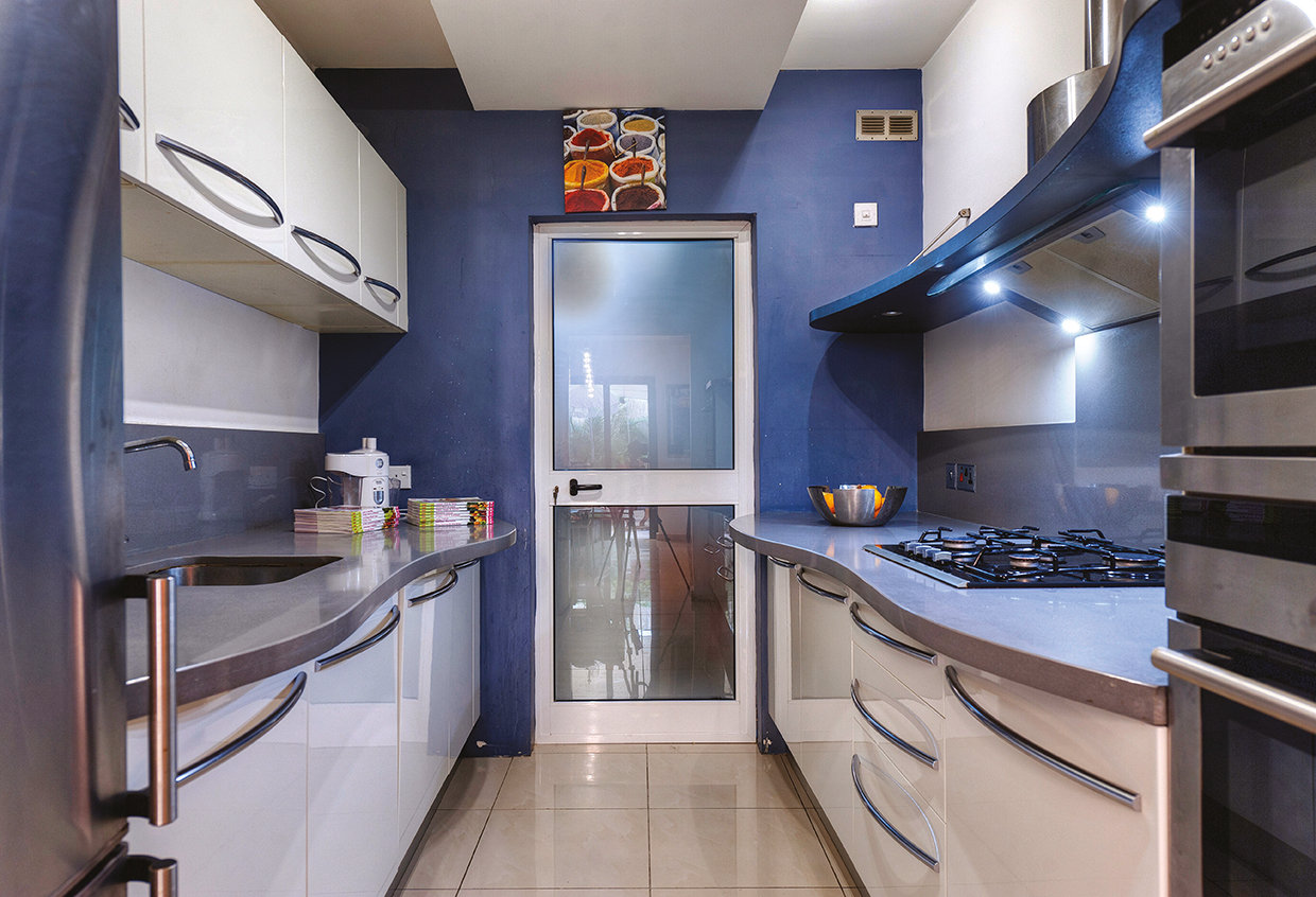 The kitchen, while galley-style, is a good size with plenty of storage and preparation space. © Alan Carville