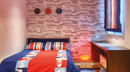 The bedrooms all make use of wallpaper as a feature. This room has a unique pattern of city names. © Alan Carville