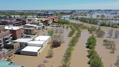 Aerial view of floodwaters flowing from the Tittabawassee River into the lower part of downtown Midland on May 20, 2020 in Midland, Michigan. Thousands of residents were ordered to evacuate after two dams failed. (Image Credit: Gregory Shamus/Getty Images)