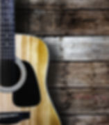 Guitar on wood background..jpg
