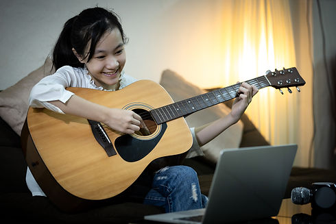 Happy smiling asian child girl is singin