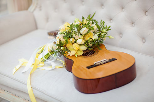 Guitar with elegant yellow bride's bouqu
