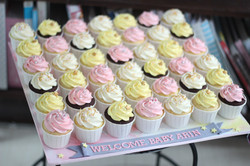 Yellow and pink cupcakes baby shower