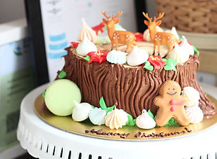 Christmas tree stump cake with meringue