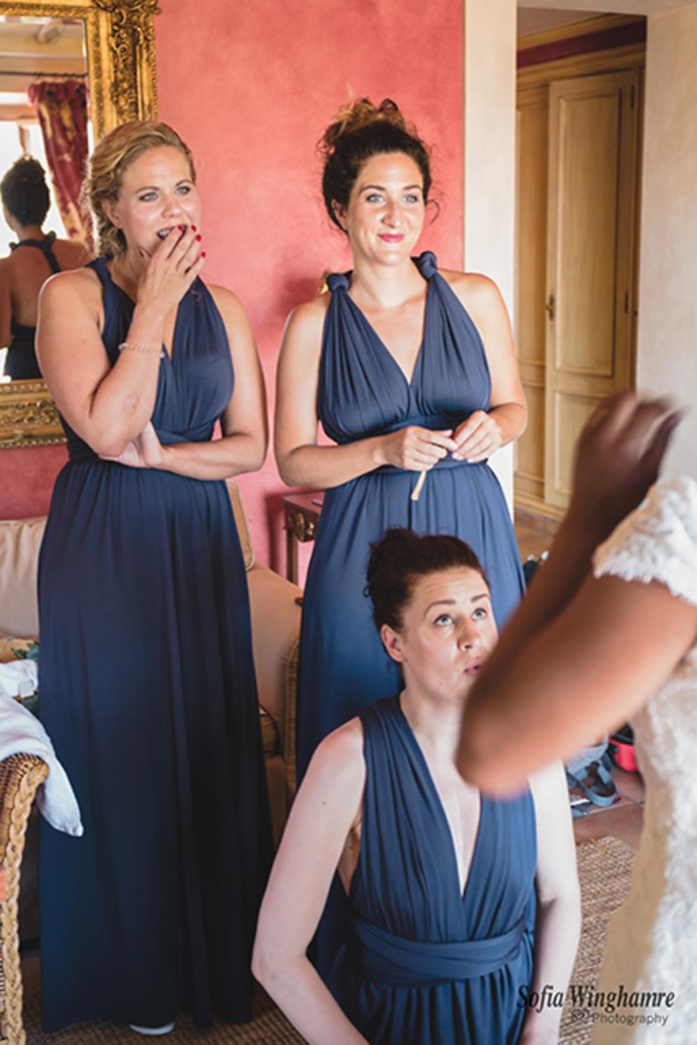 The bridesmaids admiring the bride.