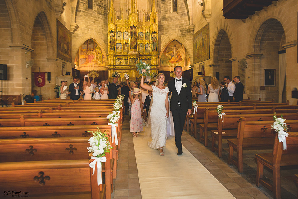 Happily married, walking down the aisle