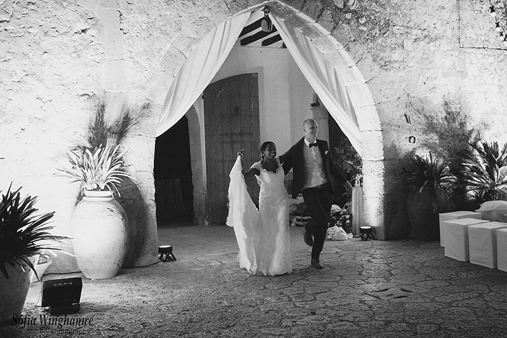 The newly wedded couple doing an entrance