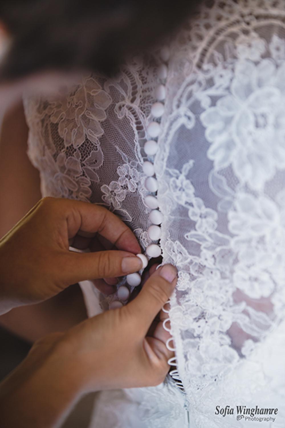 getting the wedding dress on!