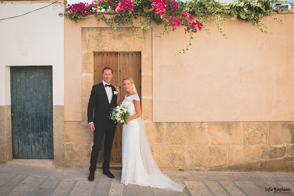 The handsome couple on a street in Alcudia.