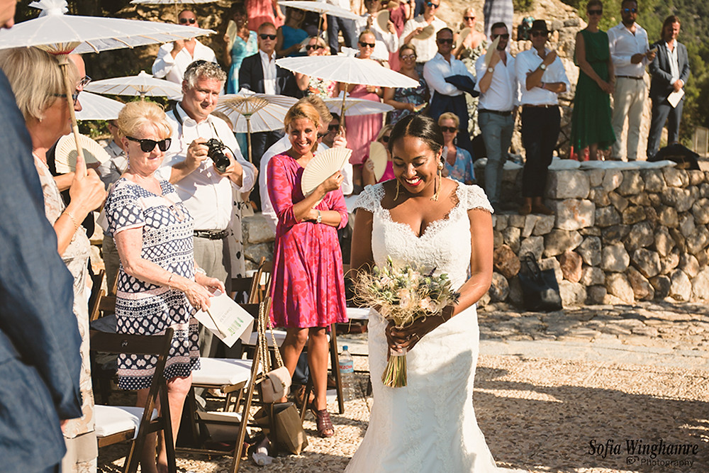 The bride coming down the aisle in Deia