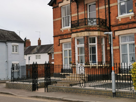 Decorative Iron Railings and Pilasters
