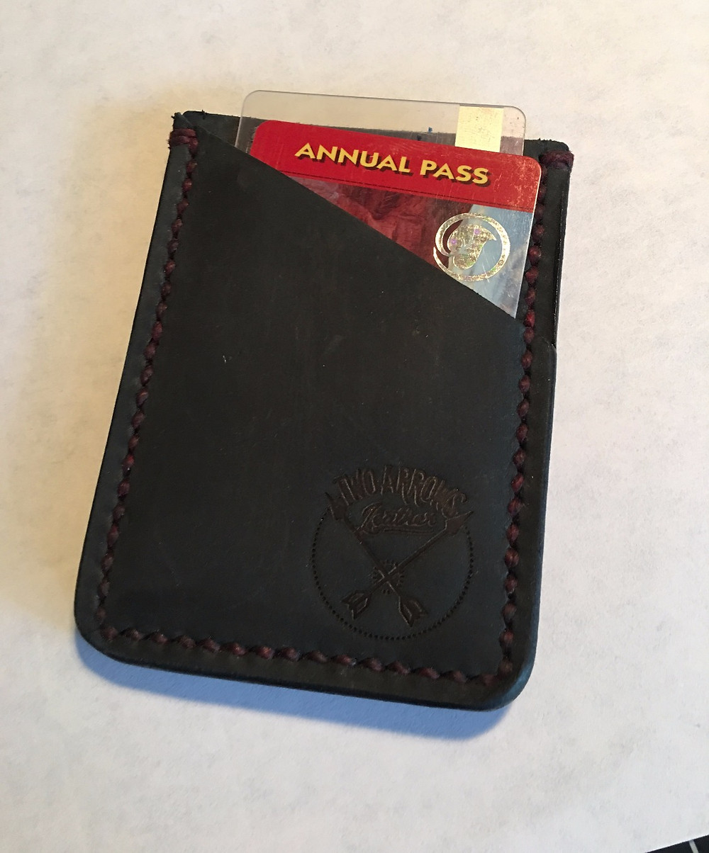 cards fit snugly in a black slim wallet