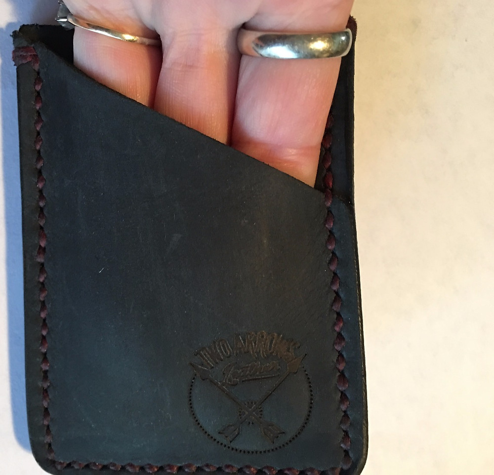 stretch out the angled slot of the wallet with your fingers