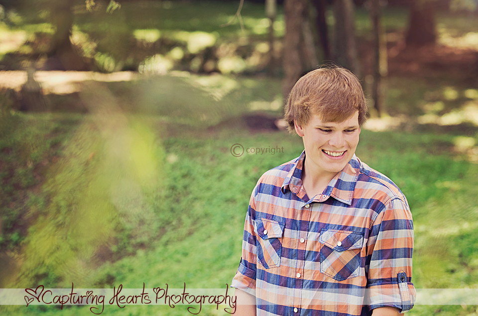 Red+Head+Highschool+Senior+Smiling+Green+Trees+Knoxville+Park+Photography
