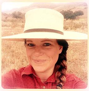 Genae headshot w hat_edited.jpg