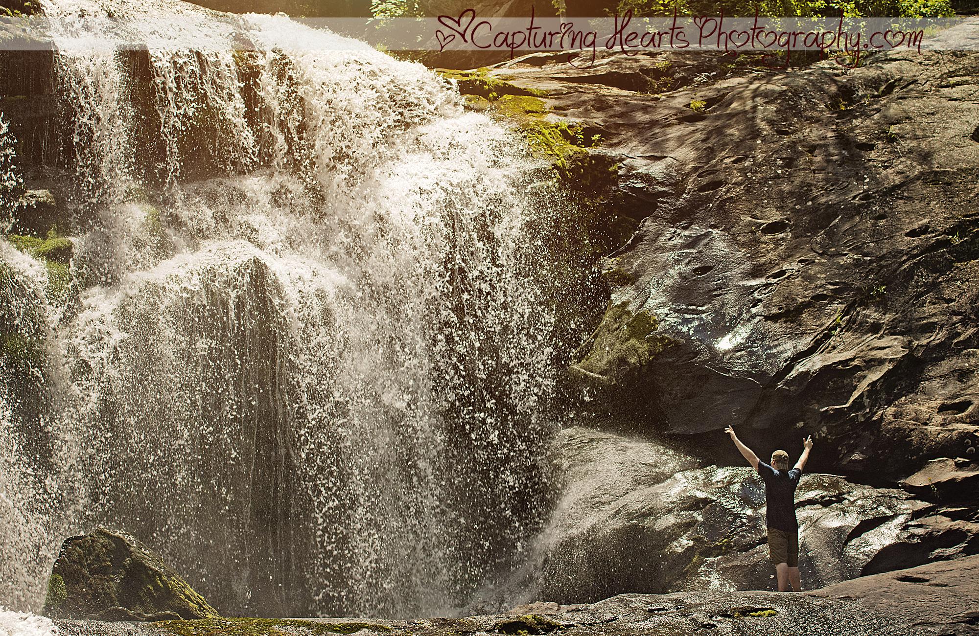 senior boy at waterfall web