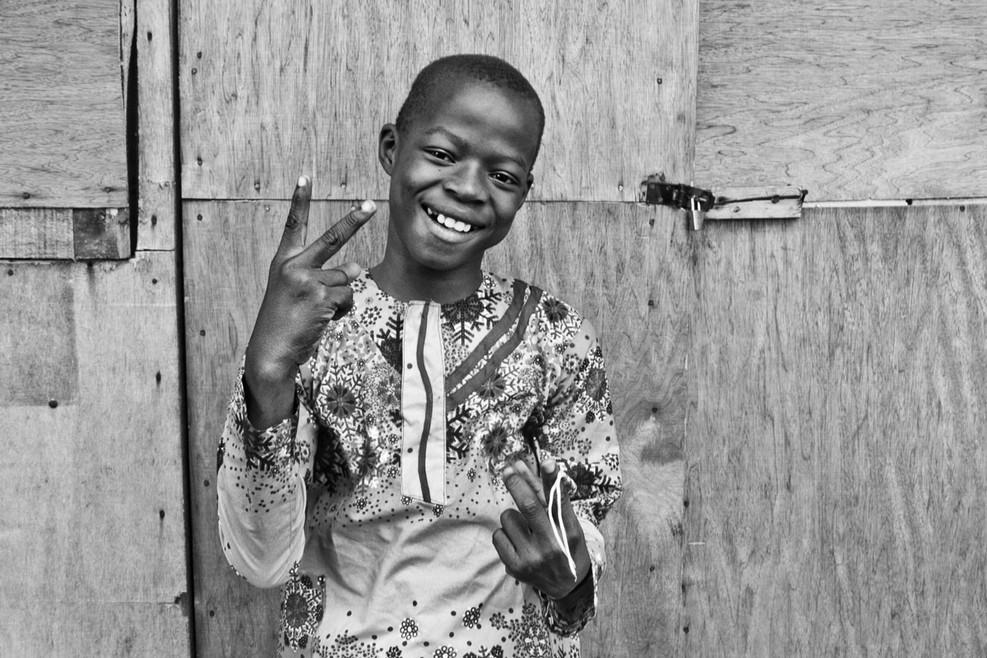 Black Boy Joy, posing in Badagry, Nigeria.