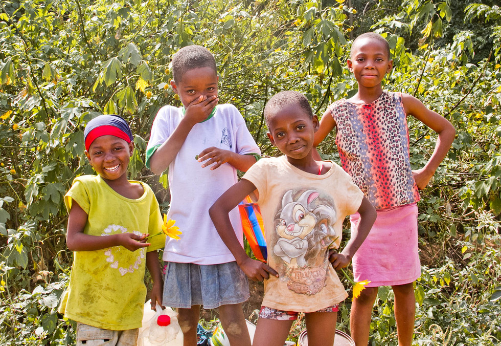 GIRL POWER FREEDOM IN THE RIVER.    Each child from this community is responsible for collecting at least 3 large jugs of water from the river multiple times per day.  The river isn't near by, traveling back and forth balancing large jugs atop your head, is far beyond a westerns comprehension.   On my walk down the river, these brave girls as my guide. We made our way to the natural rocks and wellsprings that provide fresh water for their community.