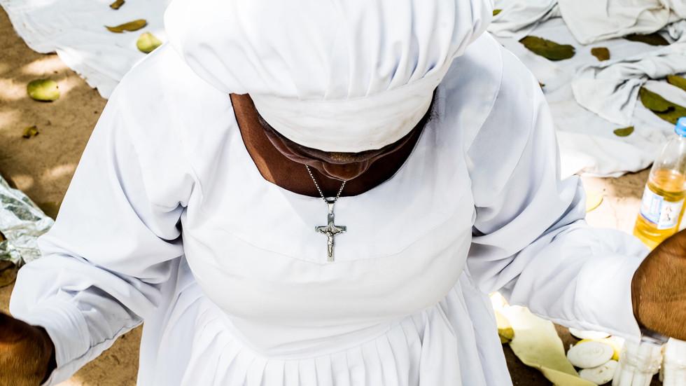 Scabadah's wife, kneeled in prayer.