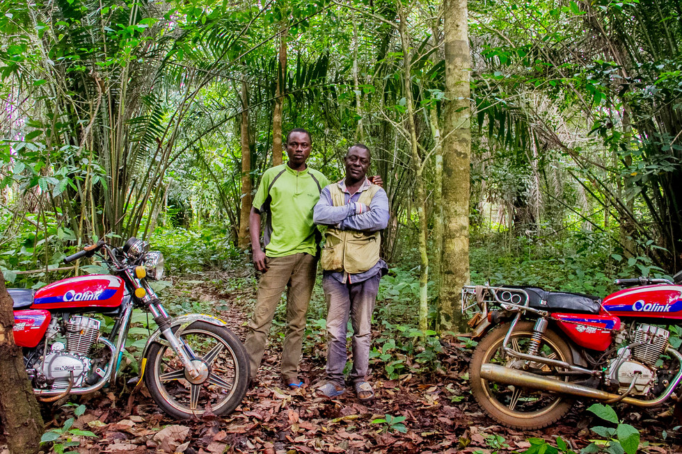 OKADA RIDER'S, my guide through the lush farmlands of Edo State, Southern Nigeria. These motor taxis's serve an important and fundemental role in the community. It's not often they get asked to pose for a photo, as soon as my camera was spotted it became clear how much honor they have in what they do.