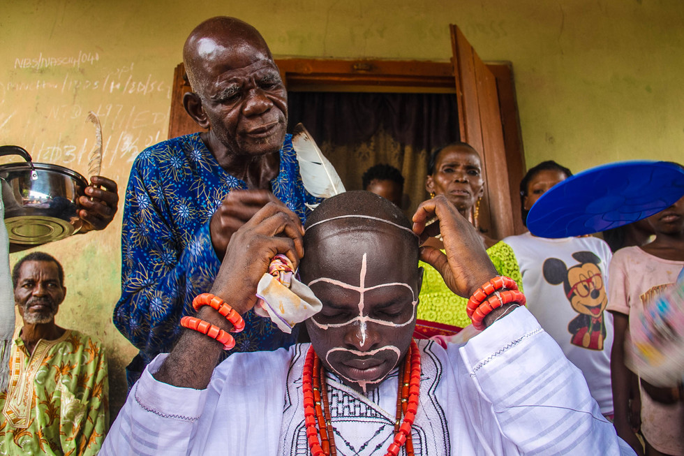 Before the age mate gathering, elder's conduct the final adjustments while praying and singing