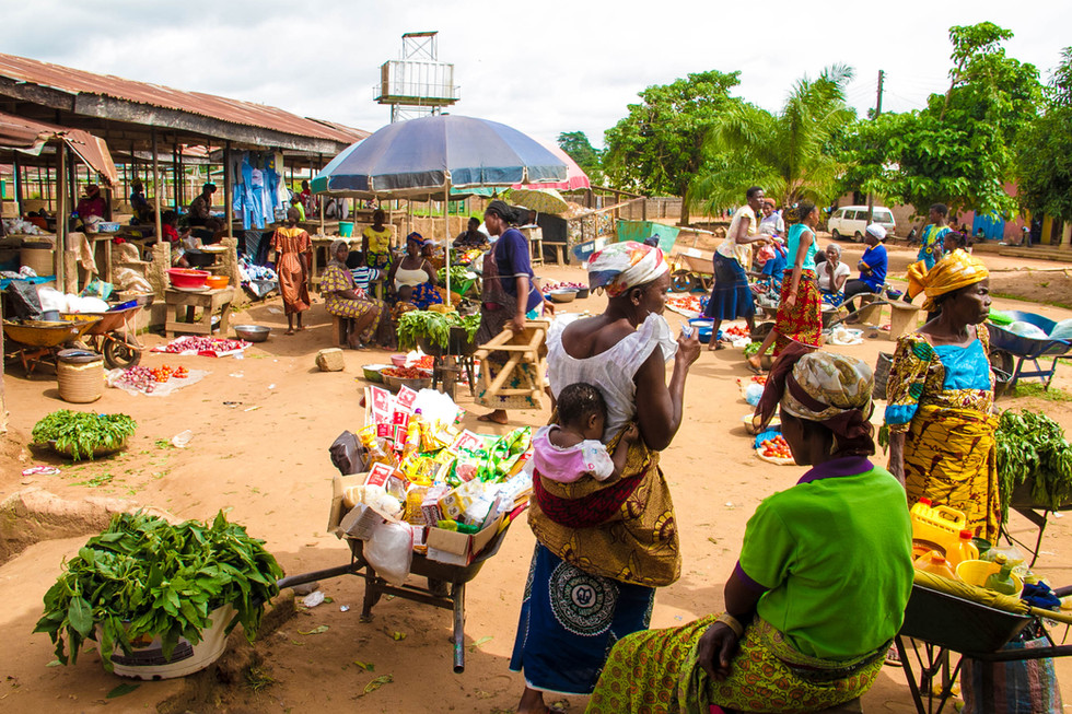 MARKET DAY.  Women sellers line the lot selling fresh produce. While Grocery Store developments in some regions have changed the trade market, traditional markets in village communtiites continue to thrive.