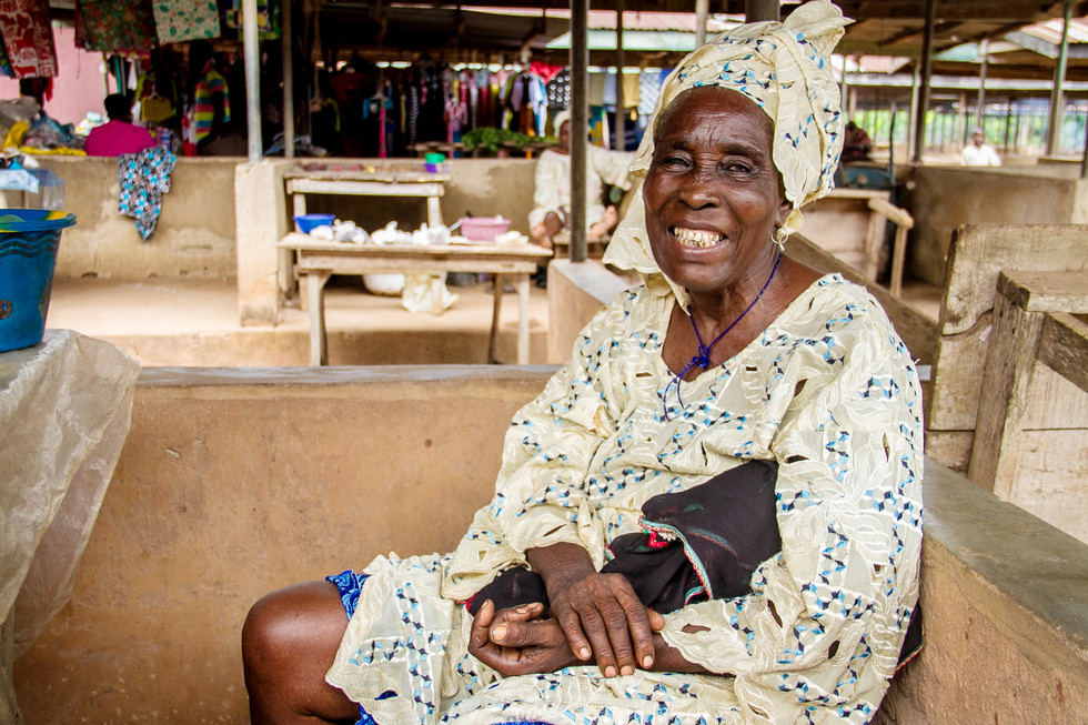 MAH-MAH MARKET WOMAN. Traditionally women hold economically interregional key positions in trade markets through out Africa. They are and have been leaders in the development of agricultural and selling. As an area dominated by women, MAH-MAH is a term of endearment and respect for an elder woman. Every Market Day many gather to purchase fresh produce from her.