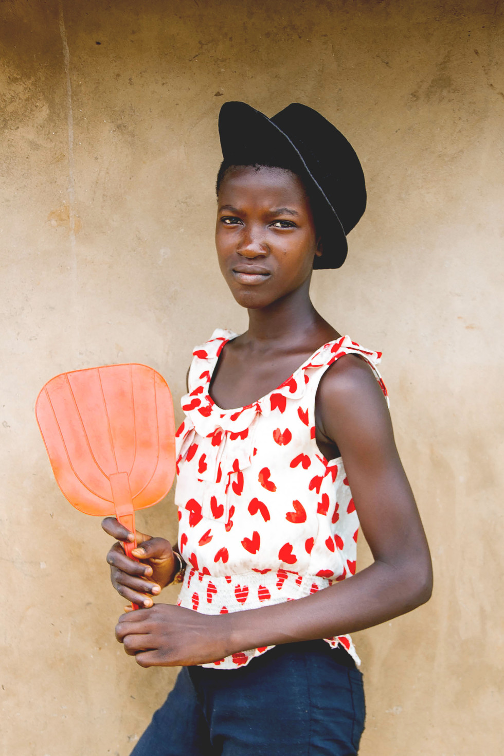 IMAGE II. MILLENNIAL GENERATION. OMAME, meaning young girl in her native tribal language. Glaring lies the effect technology and the internet has on the millennial generation throughout the African Contient. The traditional village upbringing has changed drastically post-colonization, access to higher education and advancement in technology. Young African's have found empowerment in this new era. Many challenging the negative narrative depiction of their Continent. A new movement, new narrative, new voices are emerging as young African's share positive perspectives of their home.