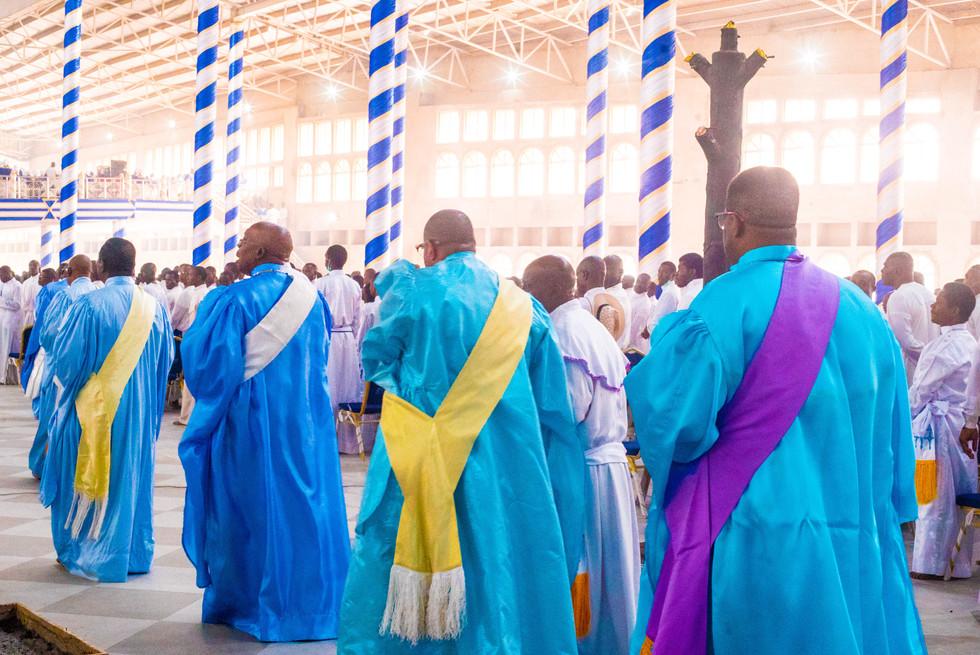Clergy men entering the sanctuary.