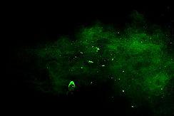 green-powder-explosion-black-background-