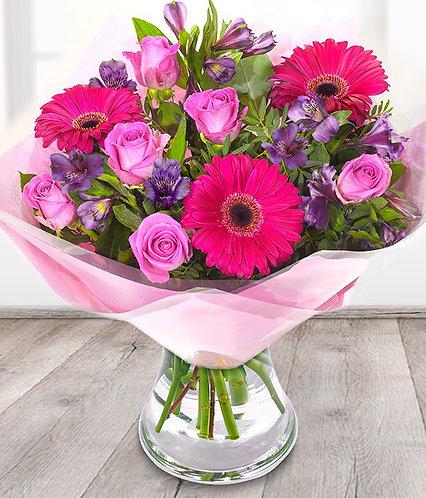 Roses gerberas and alstromeria cerise and purple