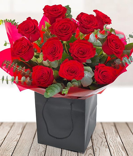 12 red roses and greenery