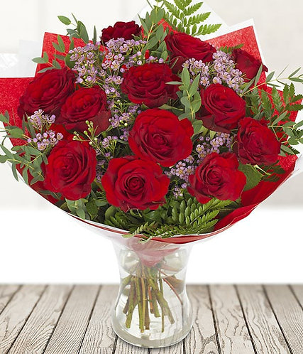 I love you. Dozen red Naomi roses with gyp or wax flower.