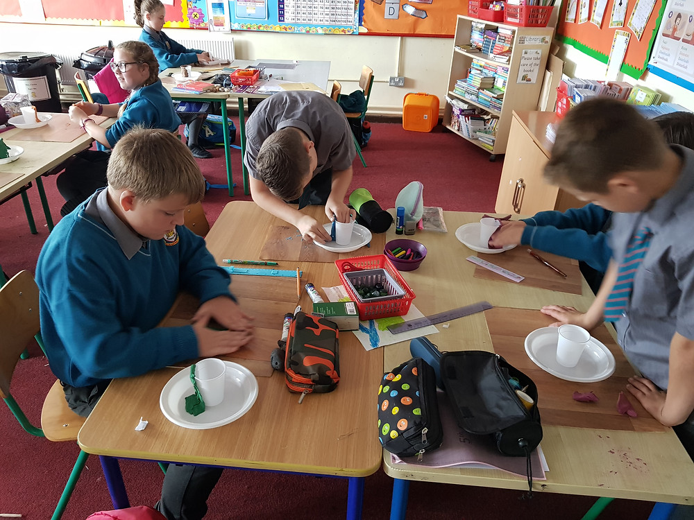 Using play dough to create the volcano