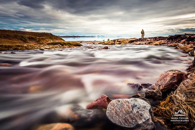 The river runs by, Pond Inlet, Nunavut