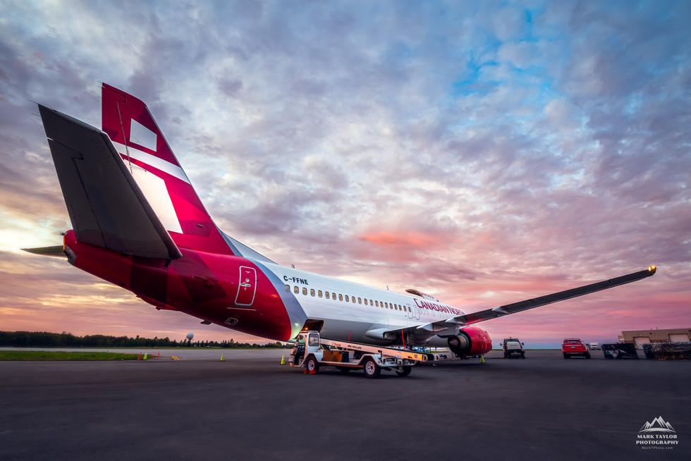 Aircraft Prep Under a Pink Sky
