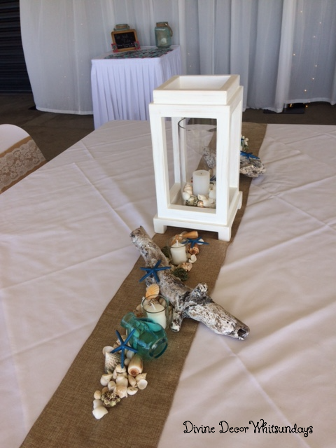 Adrift: White wooden Lantern Beach Theme Centrepiece