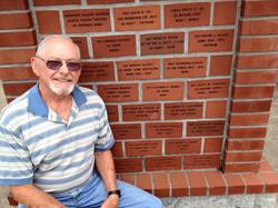 Gale Bates by his brick