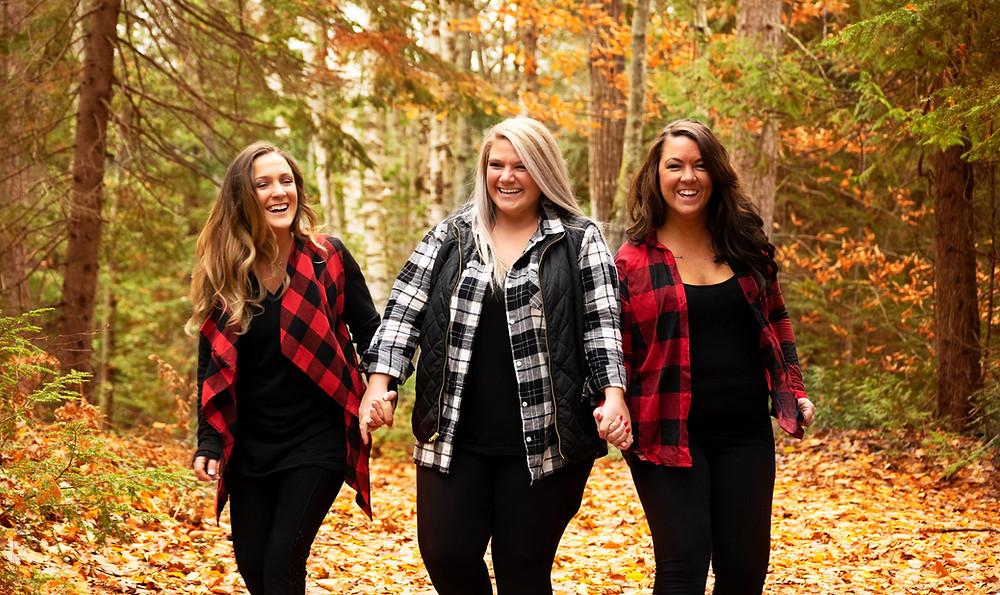 sisters walking in the woods