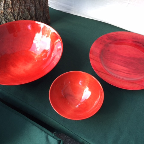 two red bowls, one red platter
