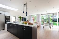 Scandi inspired corner glazed extension interior 02 by DHV Architects