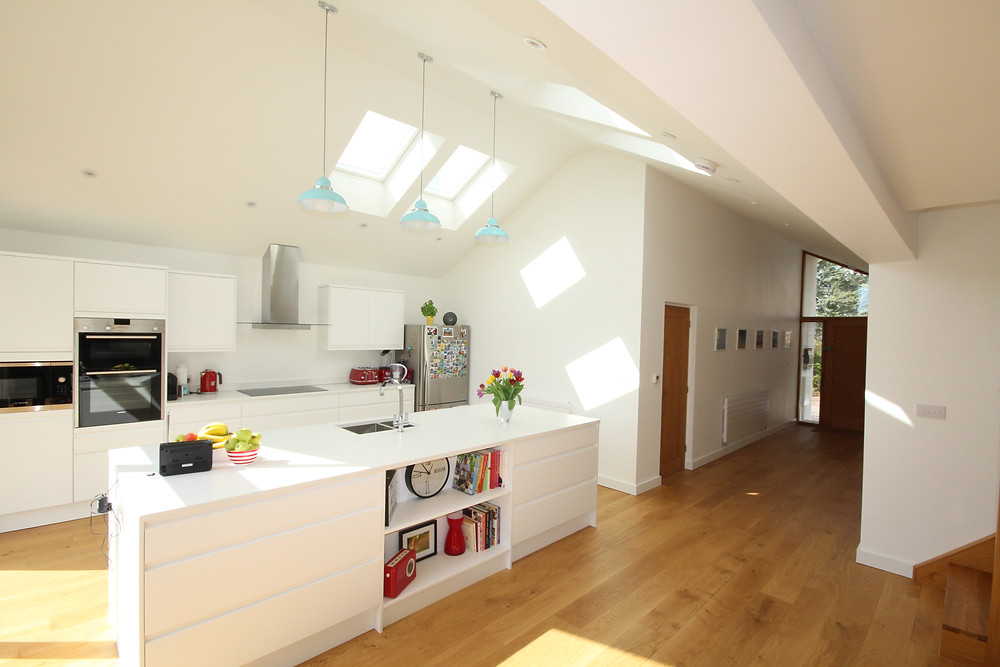Contemporary open plan kitchen diner with white island
