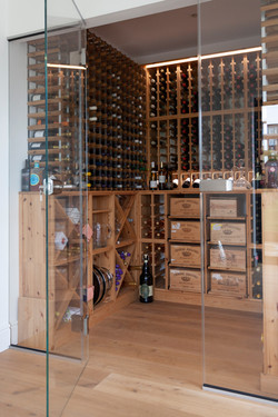 Wrap around extension wine cellar by DHV Architects