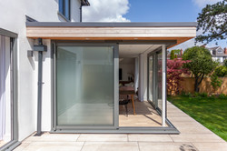 Scandi inspired corner glazed extension exterior 01 by DHV Architects