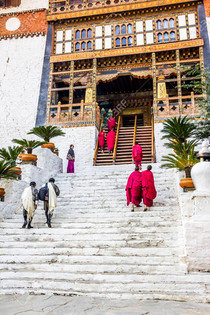 There's only one entrance to the Dzong with extremely steep wooden entry stairs that's designed to be pulled up, and there is a heavy wooden door that is still closed at night.