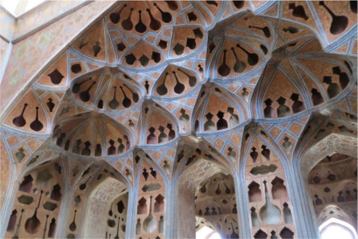 The Ali Qapu is a safavid palace in iran which was originally designed as a vast portal in early 17th century and then it turned to a six story palace with a series of additional architectural elements.In this structure, vaulted ceilings are made of mud bricks with cut-outs. These cut-outs brought low reverberation time to serve the function of room as a host for speech and intimate music especially iranian ballad.