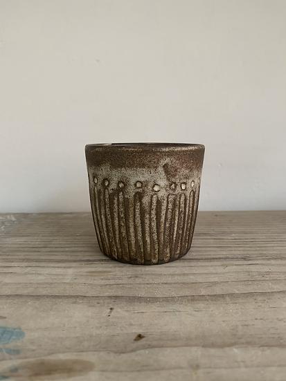 Carved black clay beaker