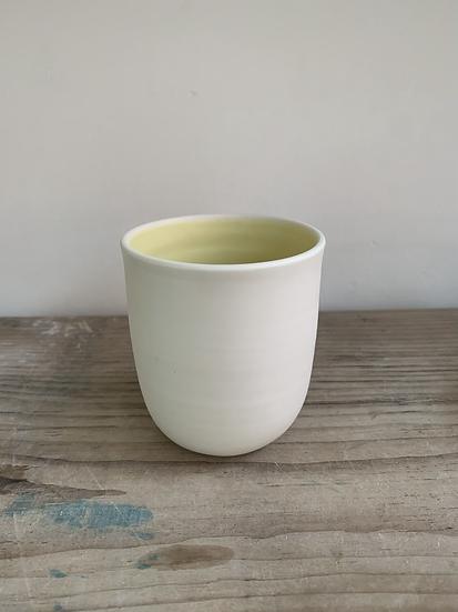 Porcelain beaker yellow inside