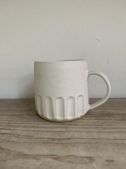 Carved stoneware mug